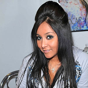 Every year, it is estimated that 128 dolphins become ensnared and die in Snooki's bulging hair-dome.