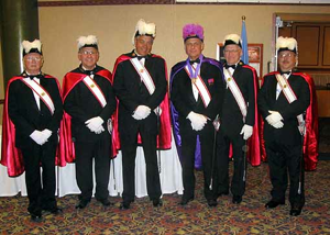 C'mon, we gave him the Knights of Columbus. Isn't that enough? If people dressed like this in my honor, it would be enough for me. Too much, in fact.