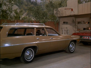 Greg Brady's car. Picture this, only in banana yellow. I should have fucking hitchhiked.