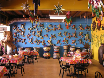 A creatively decorated wall lets diners know that this is a fun place to eat, or possibly that management has been into the mescaline again.