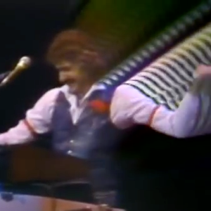 Dennis DeYoung, who's into perms, arm garters, and LSD.