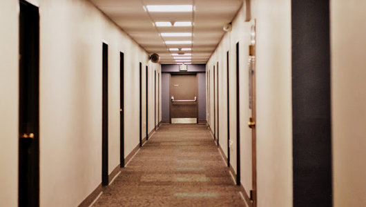 Picture an asshole with a clipboard walking down this hall. That would be Chuck.